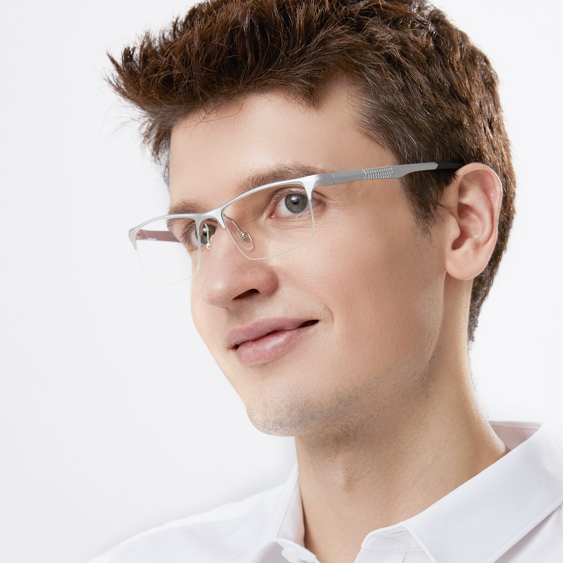 Men's lifestyle photography of XL9021 in Silver with Clear Blue Light Blocking Lenses