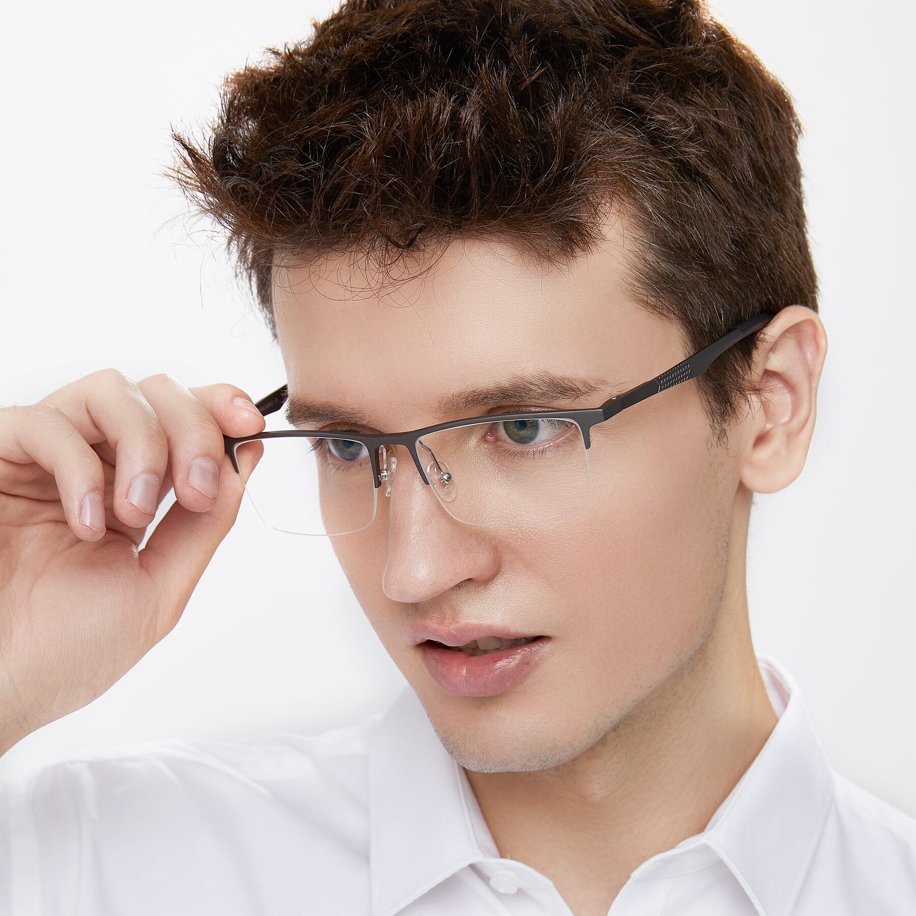 Men's lifestyle photography of XL9020 in Gunmental with Clear Eyeglass Lenses