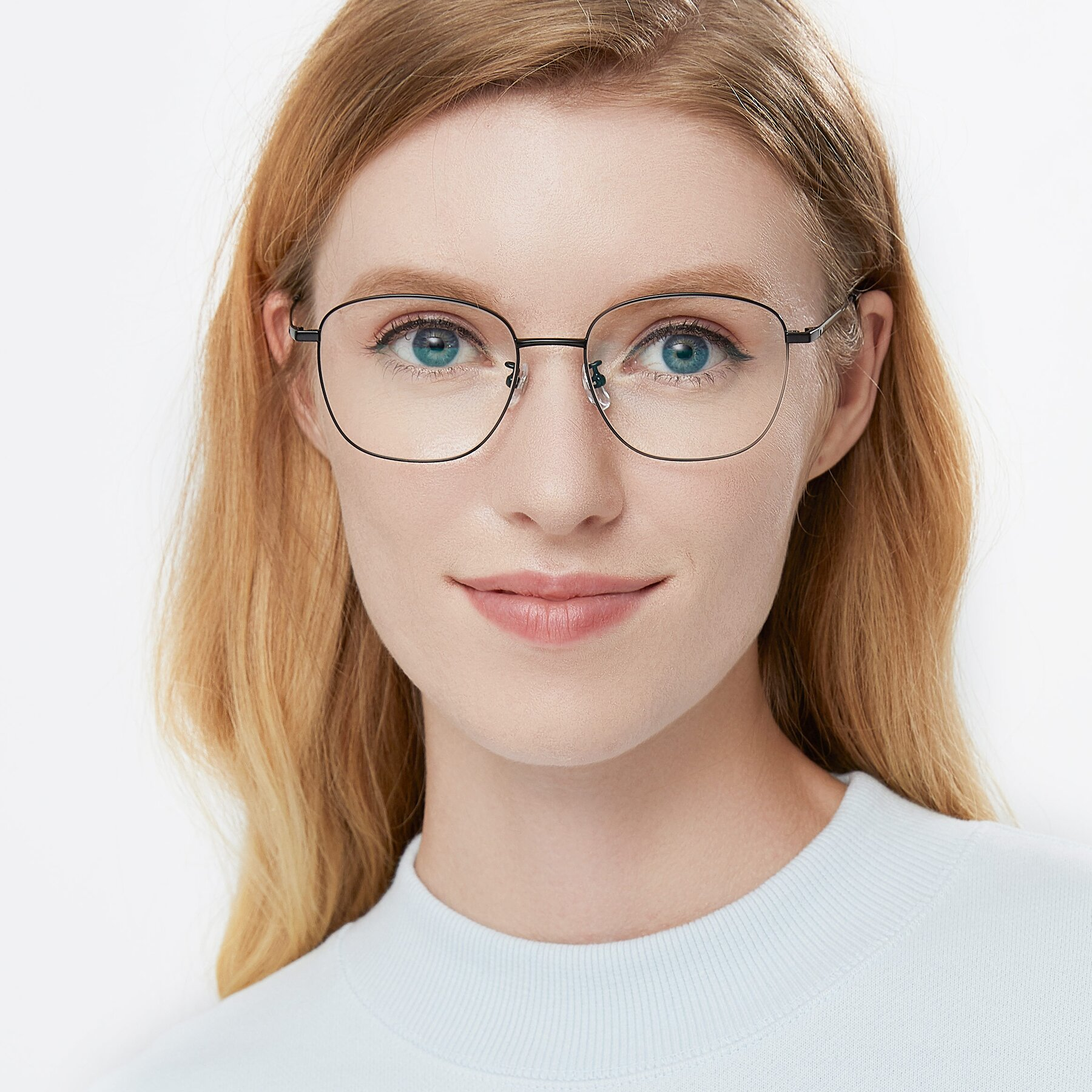 Women's lifestyle photography of Tim in Black with Clear Eyeglass Lenses