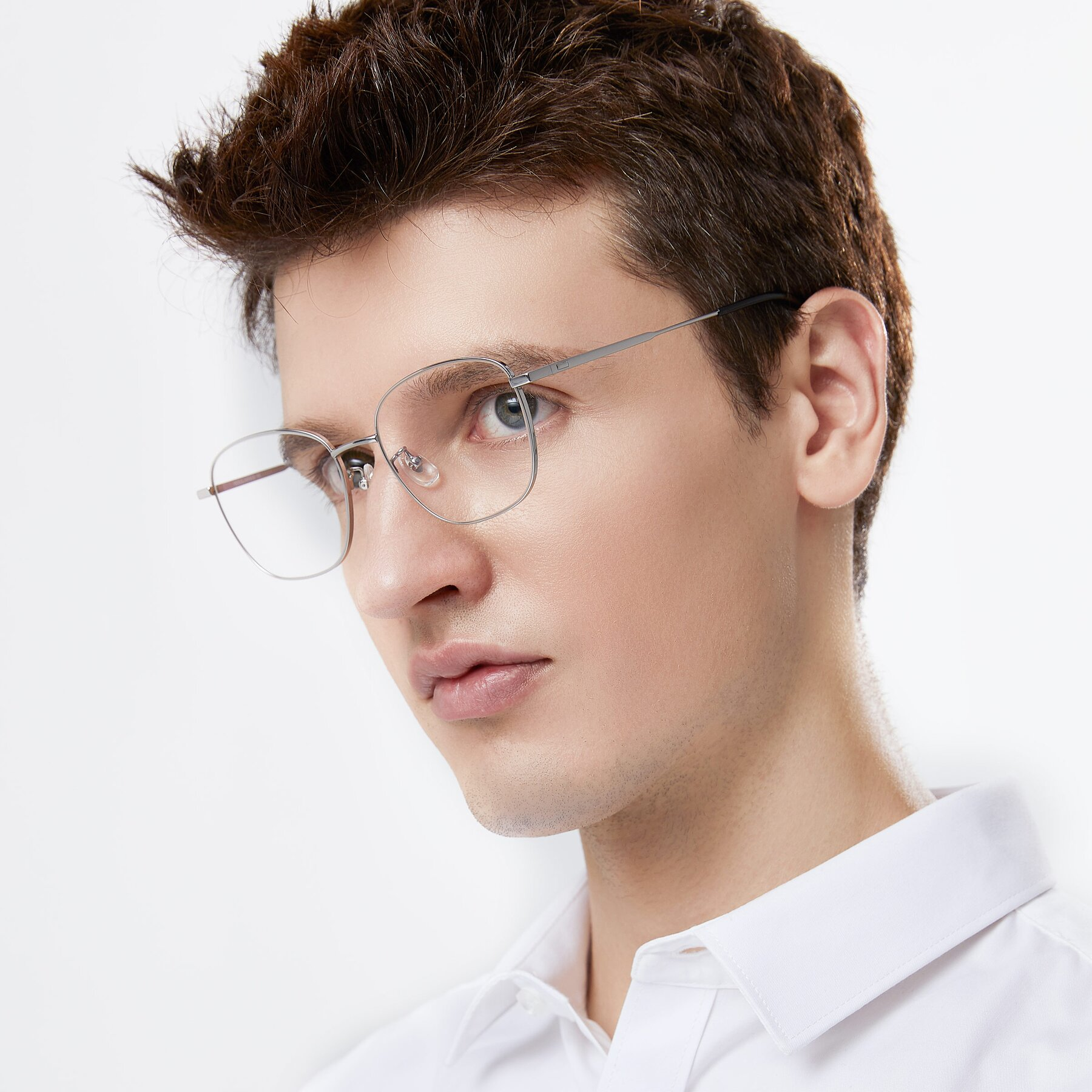 Men's lifestyle photography of Tim in Silver with Clear Blue Light Blocking Lenses