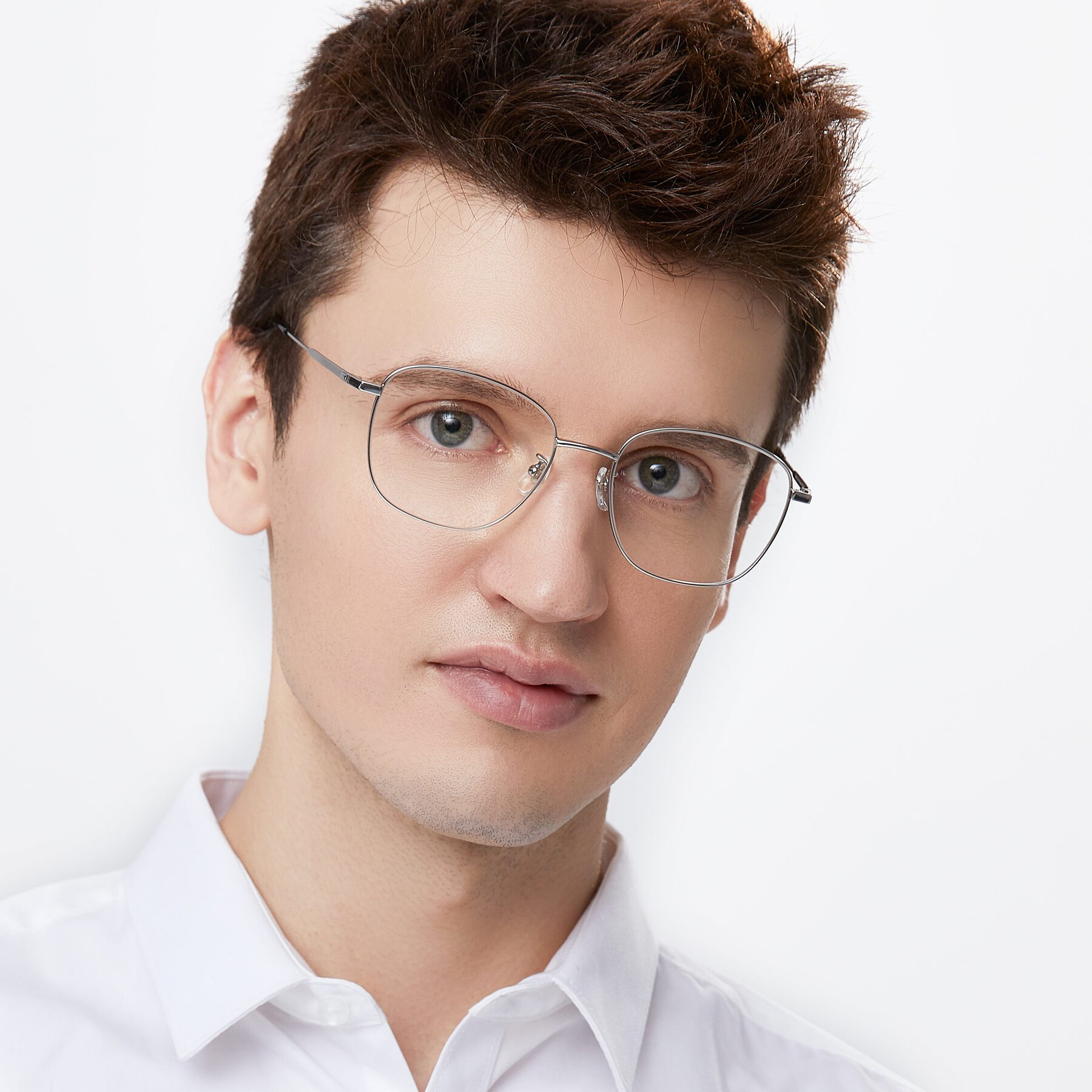 Men's lifestyle photography of Tim in Silver with Clear Eyeglass Lenses