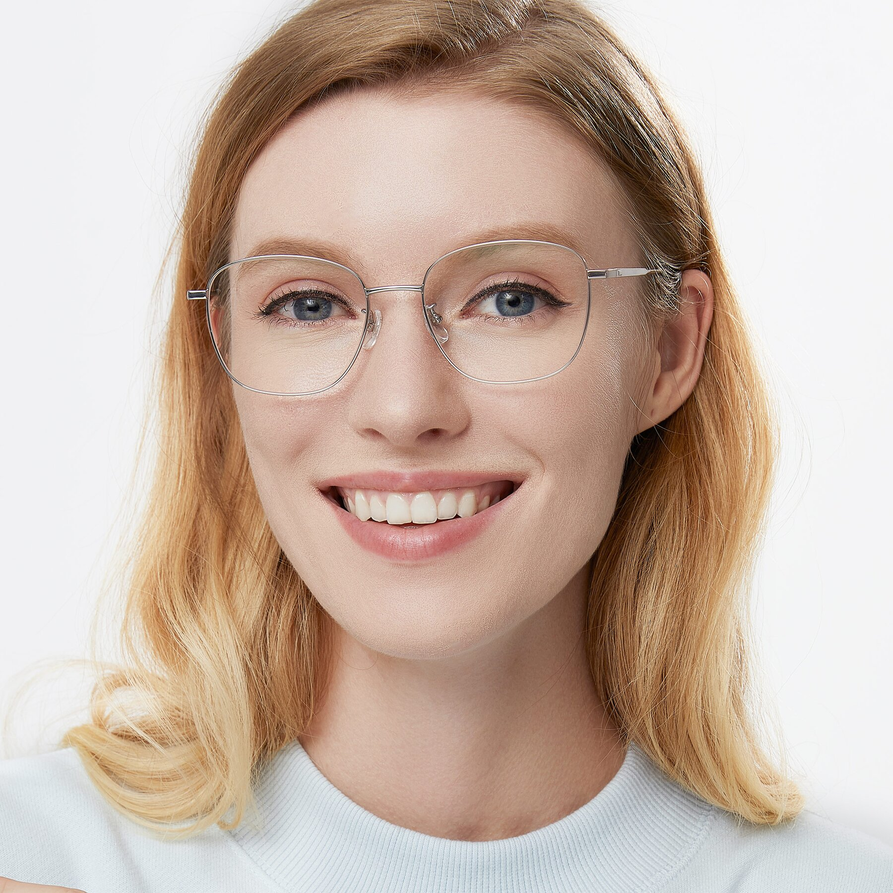 Women's lifestyle photography of Tim in Silver with Clear Eyeglass Lenses