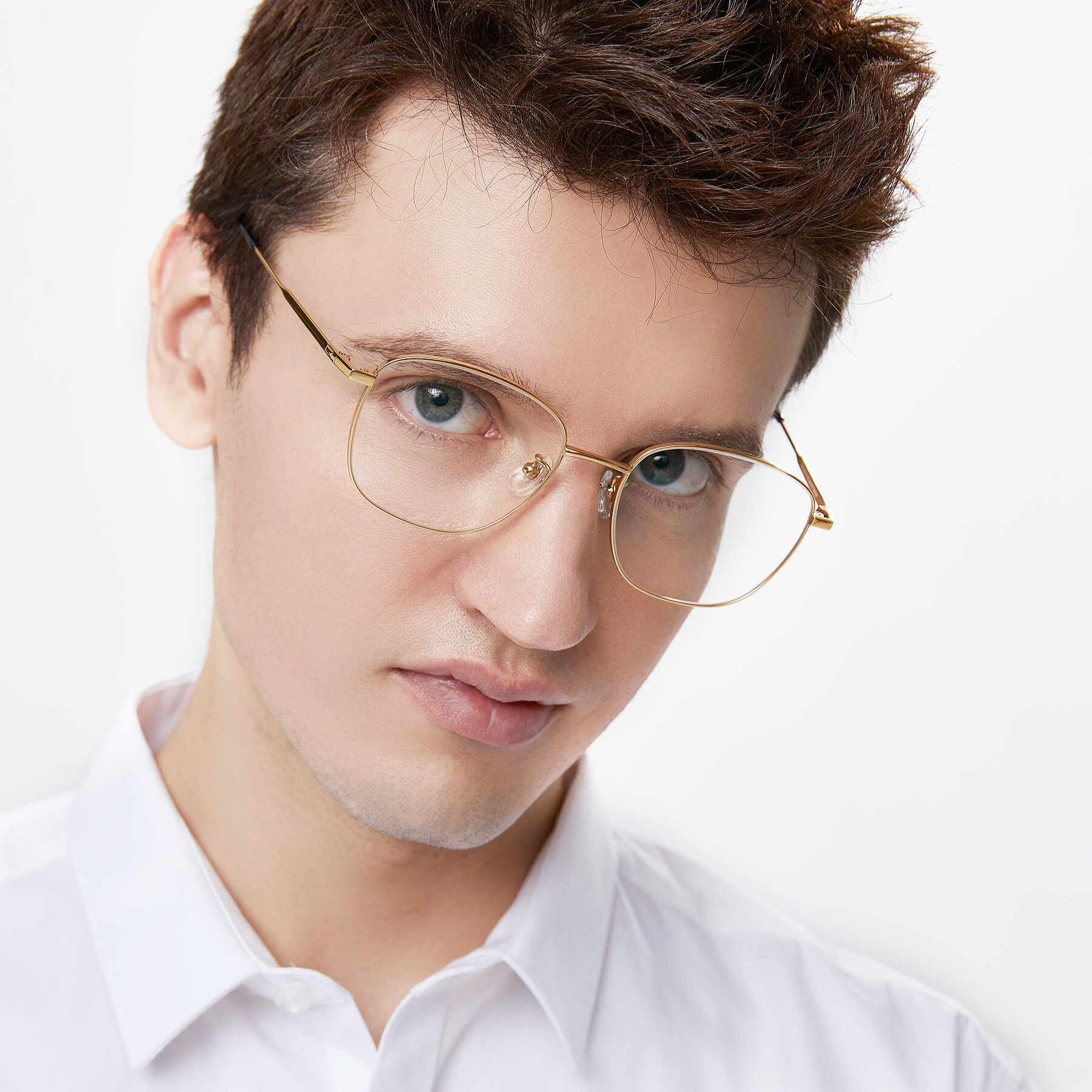 Men's lifestyle photography of Tim in Gold with Clear Eyeglass Lenses