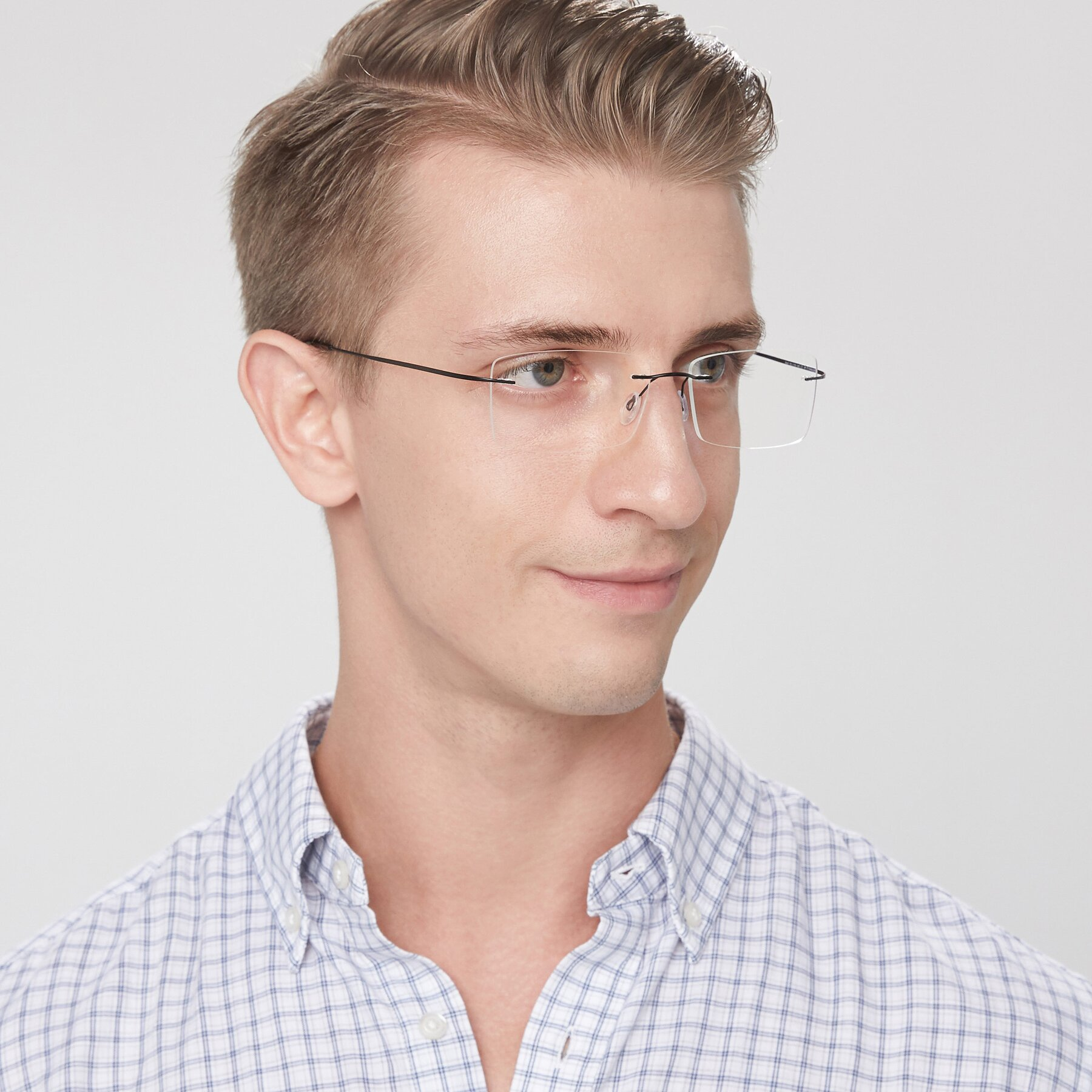Men's lifestyle photography of Wall in Black with Clear Eyeglass Lenses