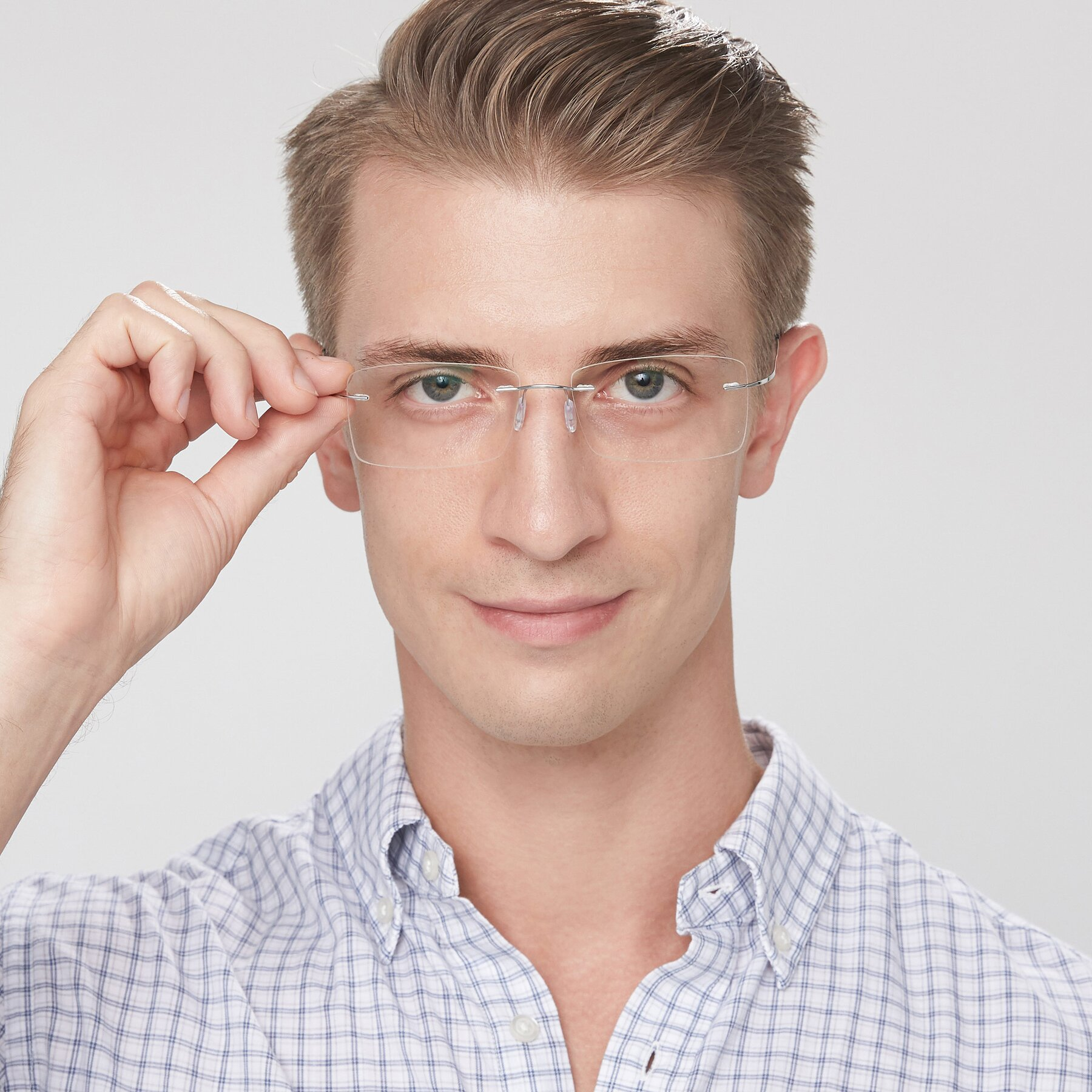 Men's lifestyle photography of Wall in Silver with Clear Eyeglass Lenses