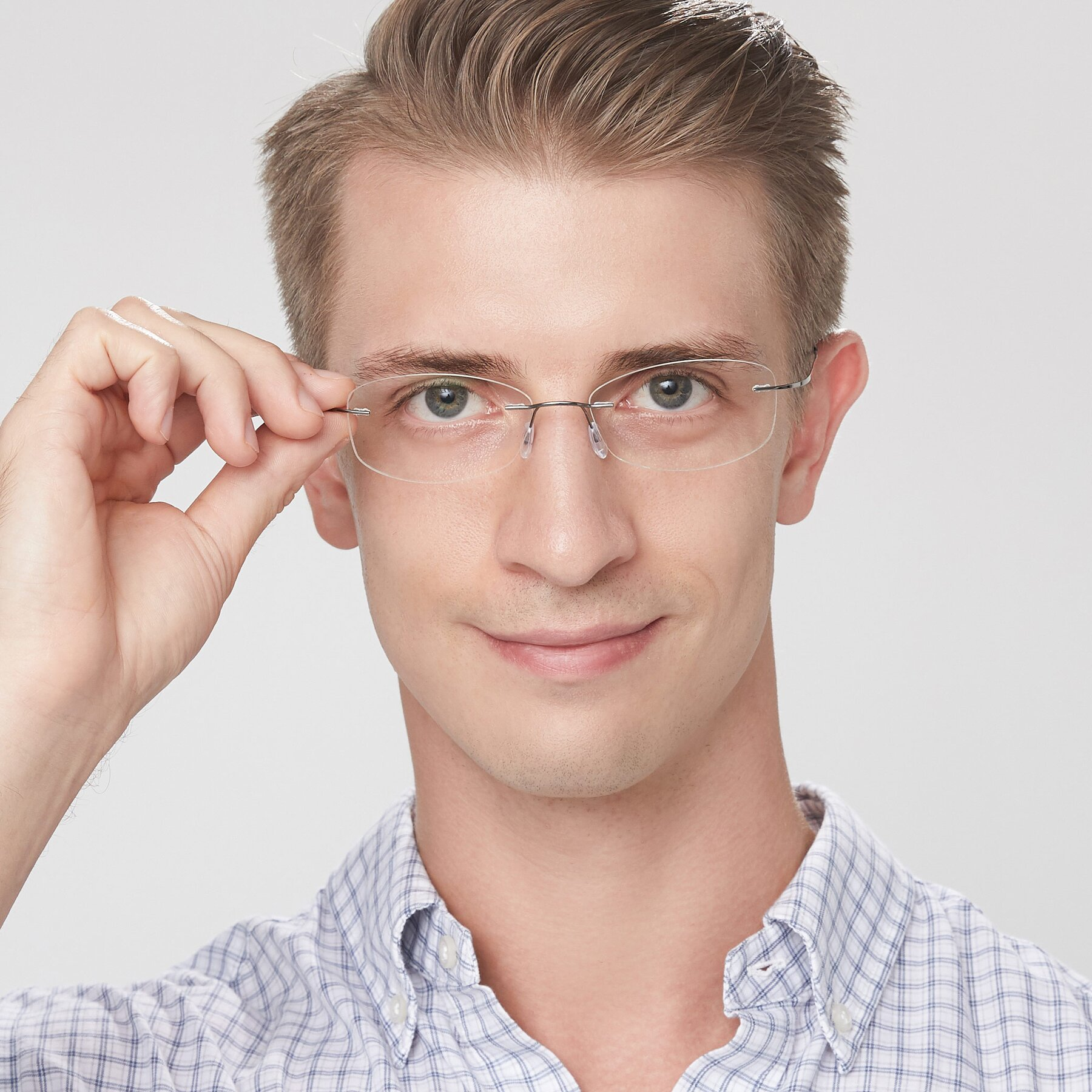 Men's lifestyle photography of Cobble in Gunmetal with Clear Eyeglass Lenses