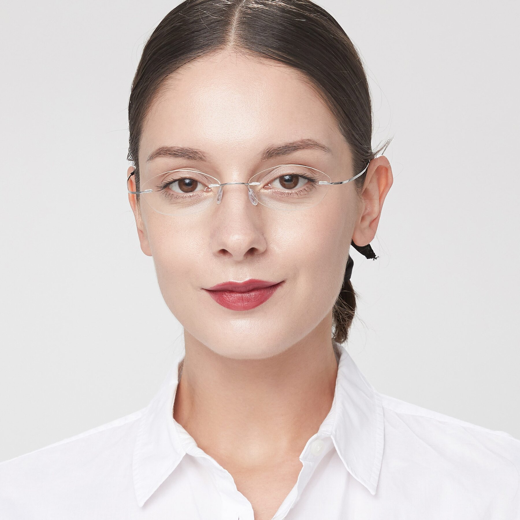 Women's lifestyle photography of Marv in Silver with Clear Eyeglass Lenses