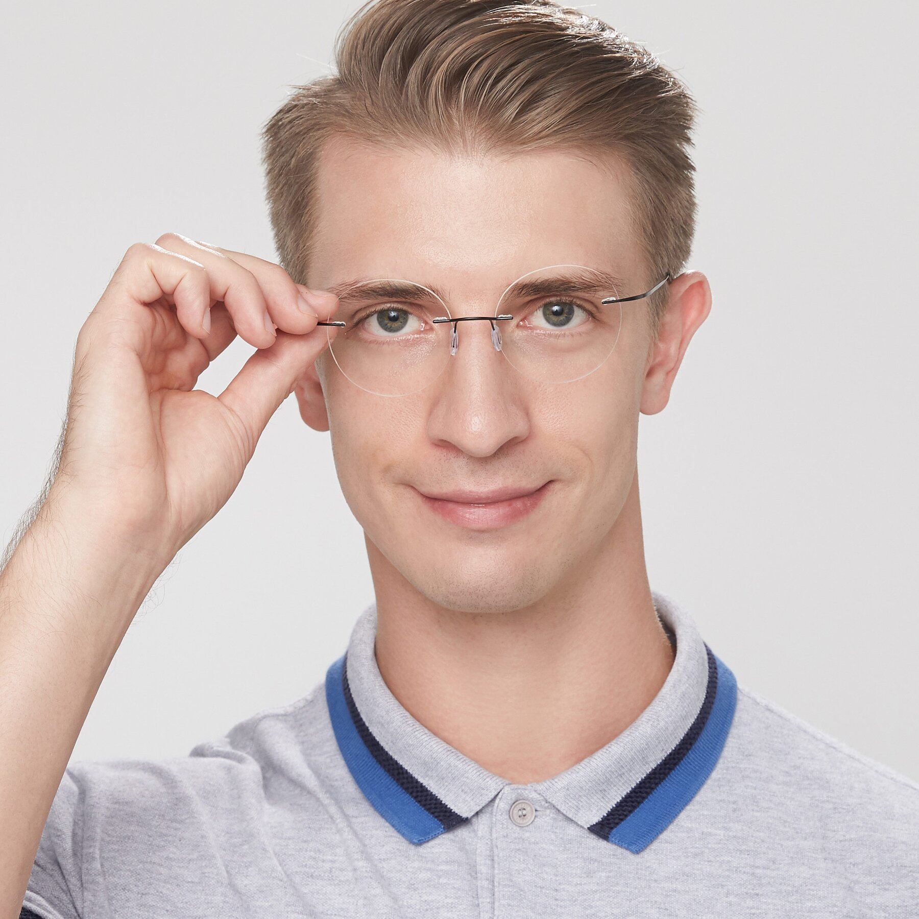 Men's lifestyle photography of Leon in Black with Clear Blue Light Blocking Lenses