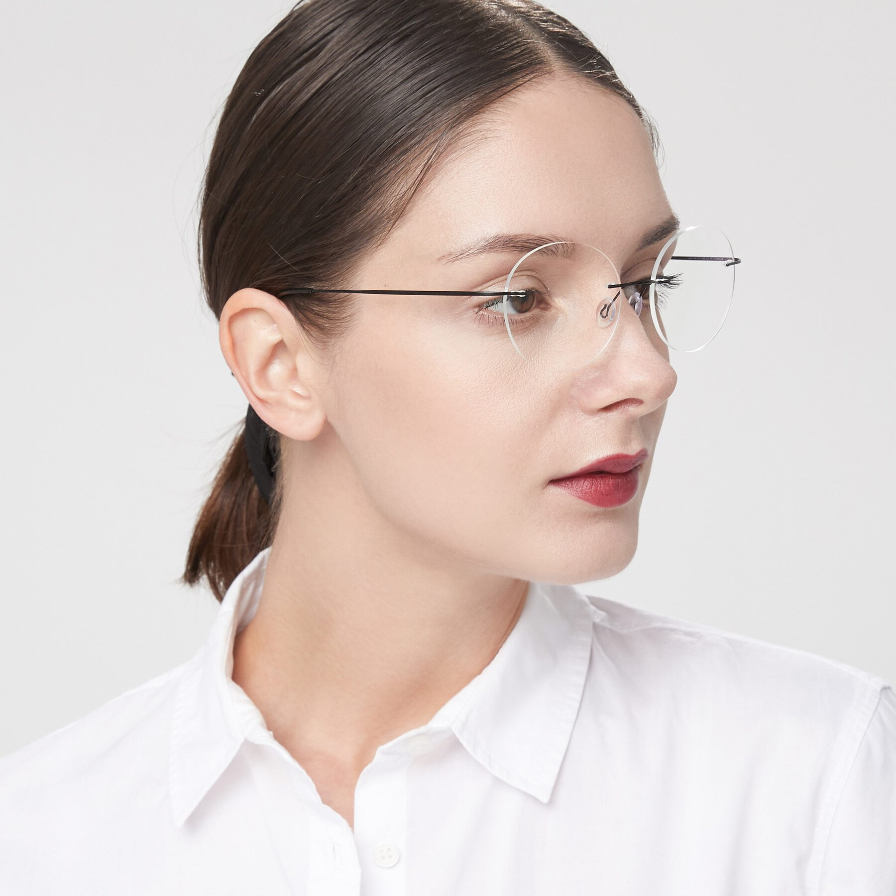 Women's lifestyle photography of Leon in Black with Clear Eyeglass Lenses