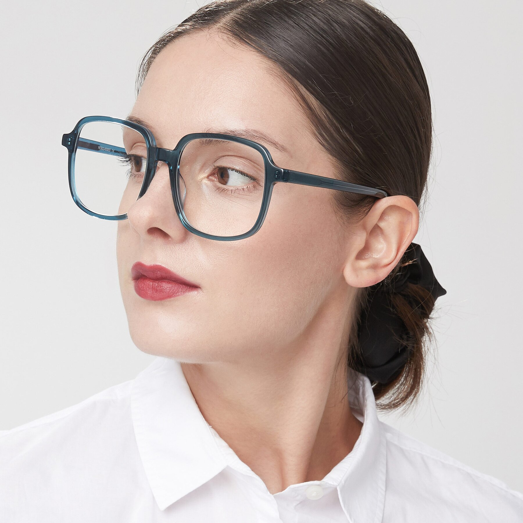 Women's lifestyle photography of Water in Transparent Cyan with Clear Eyeglass Lenses