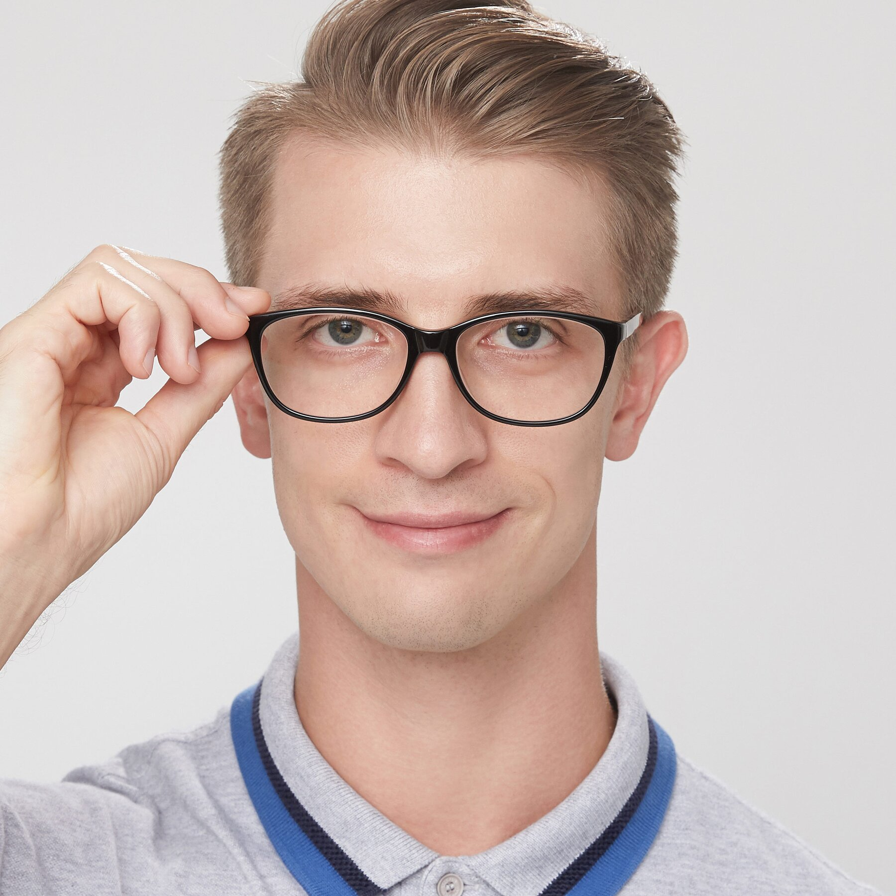 Men's lifestyle photography of Xavier in Black with Clear Eyeglass Lenses