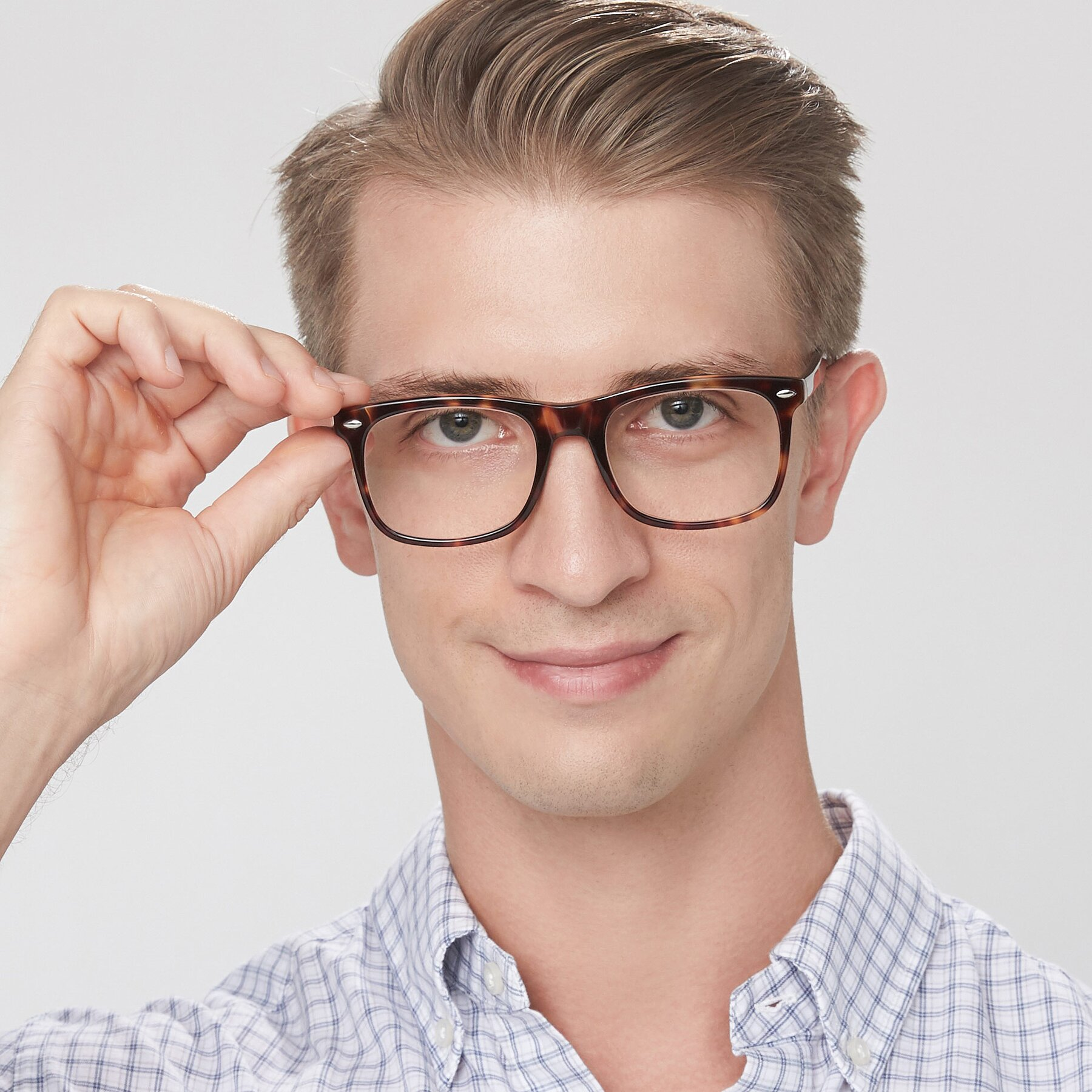Men's lifestyle photography of 007 in Yellow Tortoise with Clear Eyeglass Lenses