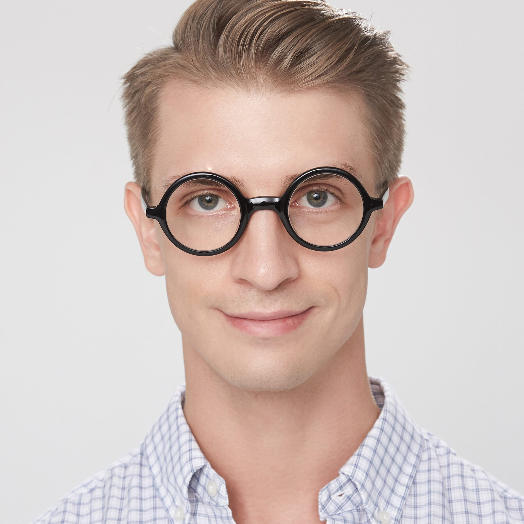 Men's lifestyle photography of Chaplin in Black with Clear Eyeglass Lenses