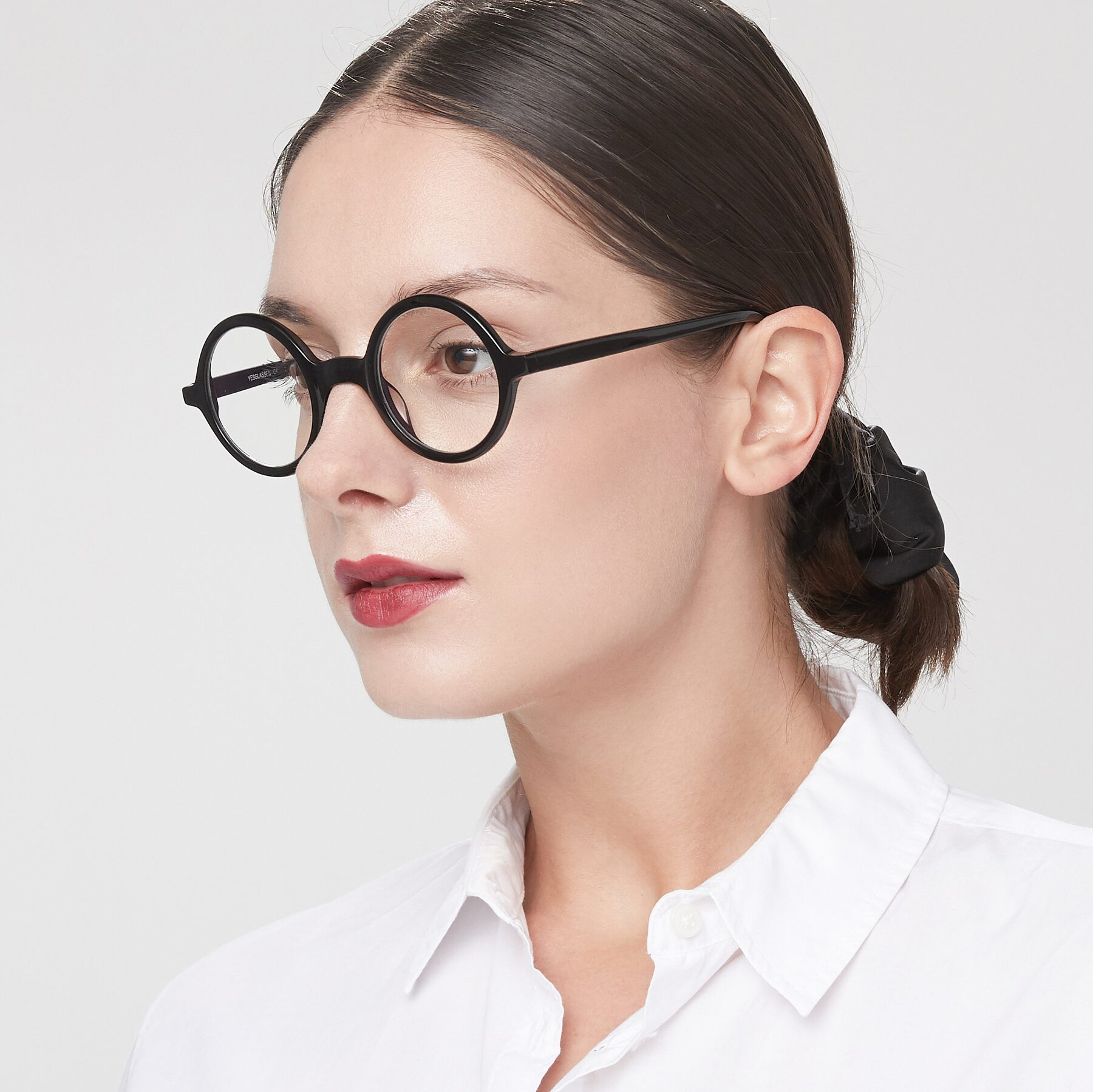 Women's lifestyle photography of Chaplin in Black with Clear Eyeglass Lenses
