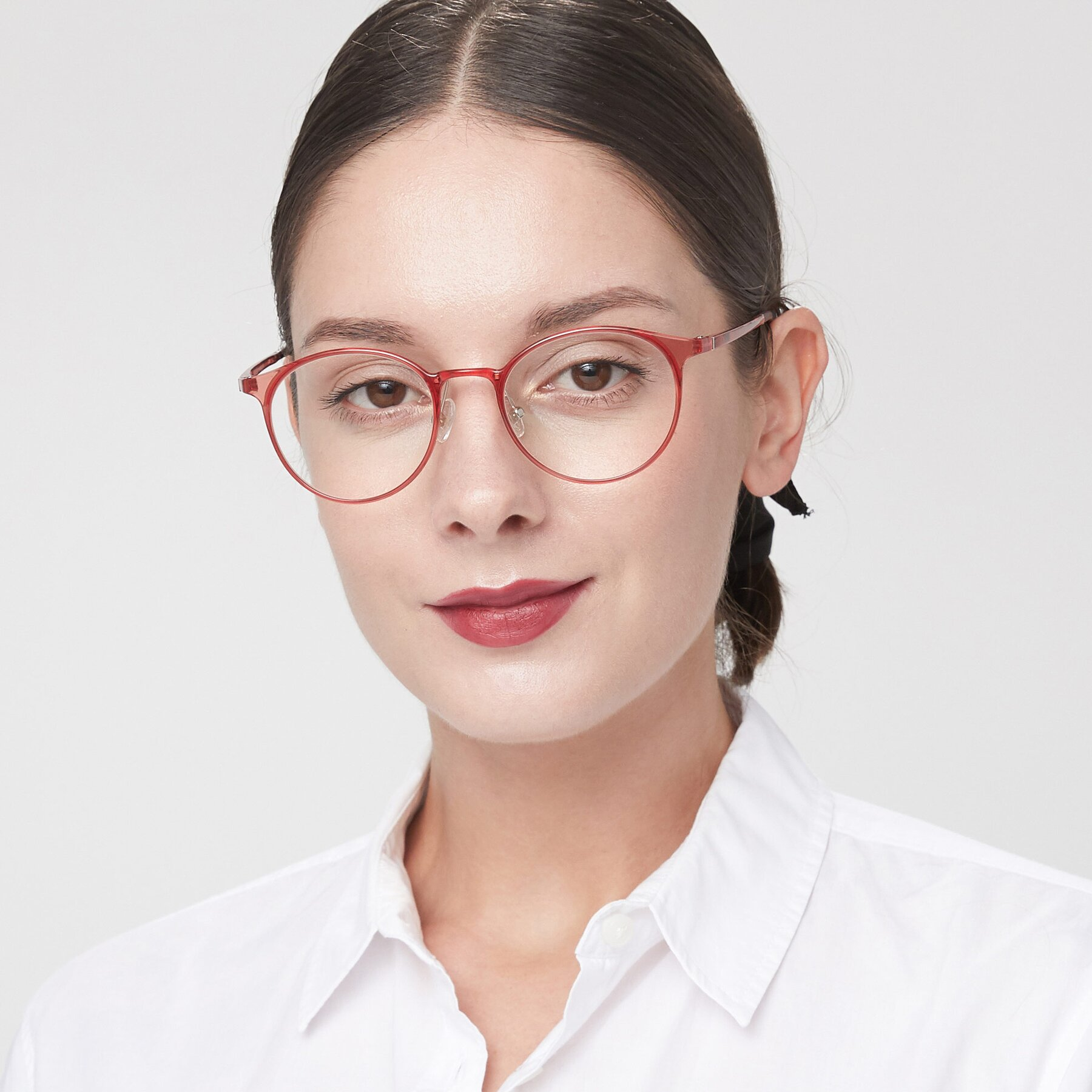 Women's lifestyle photography of S7027 in Transparent Red with Clear Blue Light Blocking Lenses