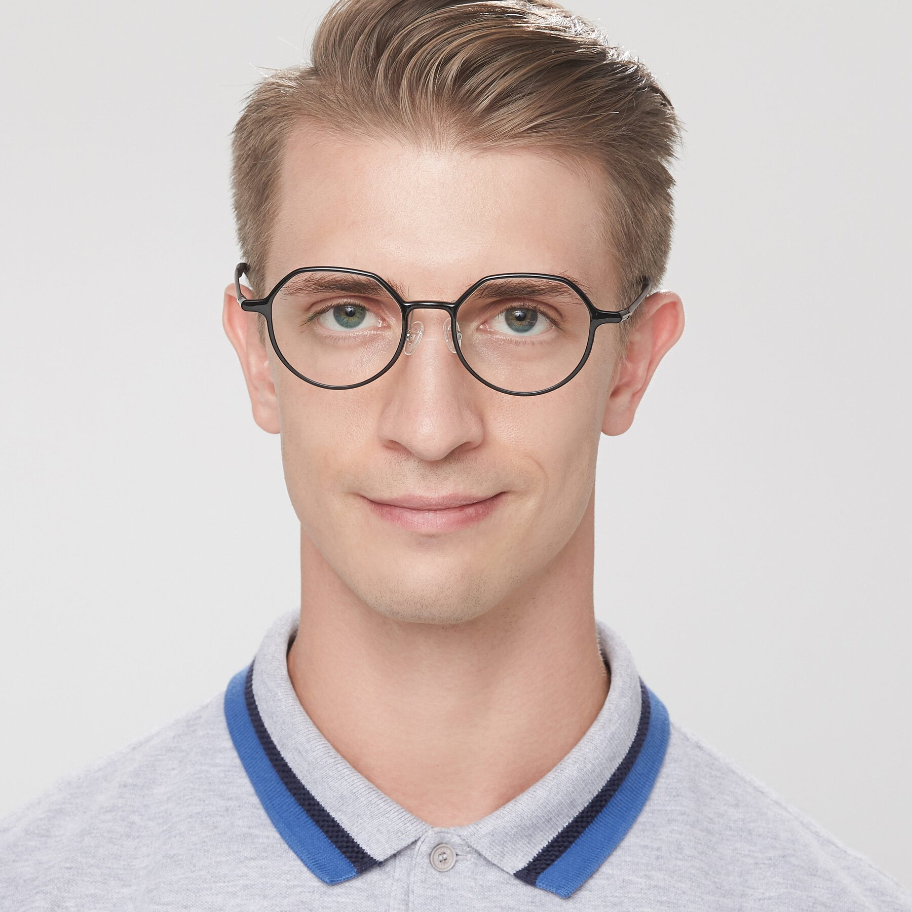 Men's lifestyle photography of IP7033 in Black with Clear Blue Light Blocking Lenses