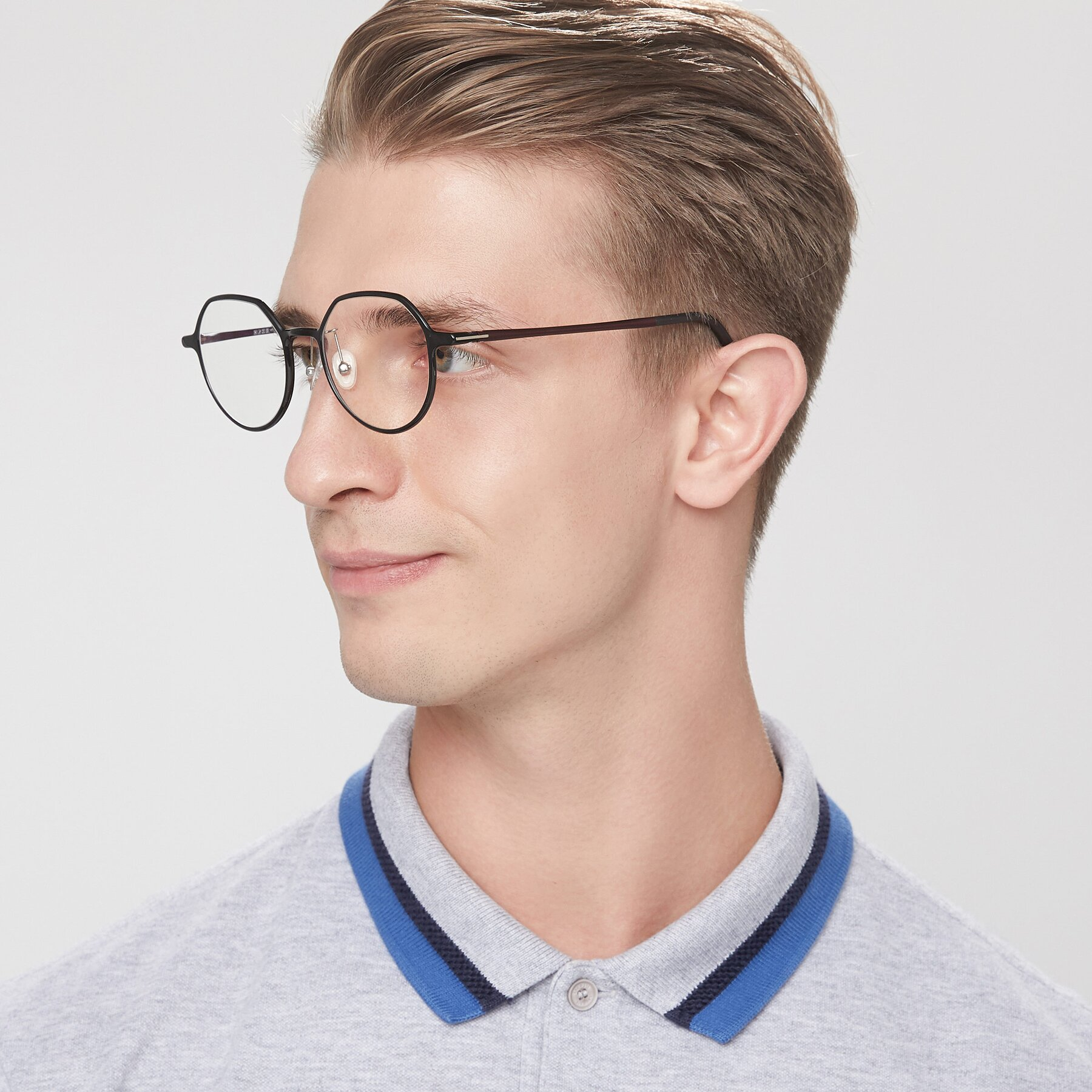 Men's lifestyle photography of IP7033 in Black with Clear Eyeglass Lenses