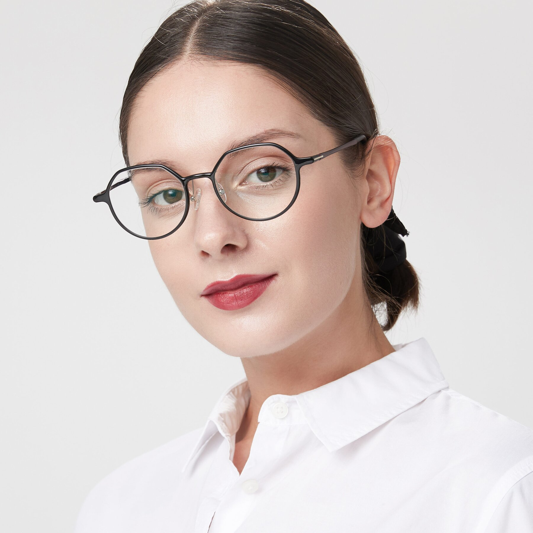 Women's lifestyle photography of IP7033 in Black with Clear Eyeglass Lenses