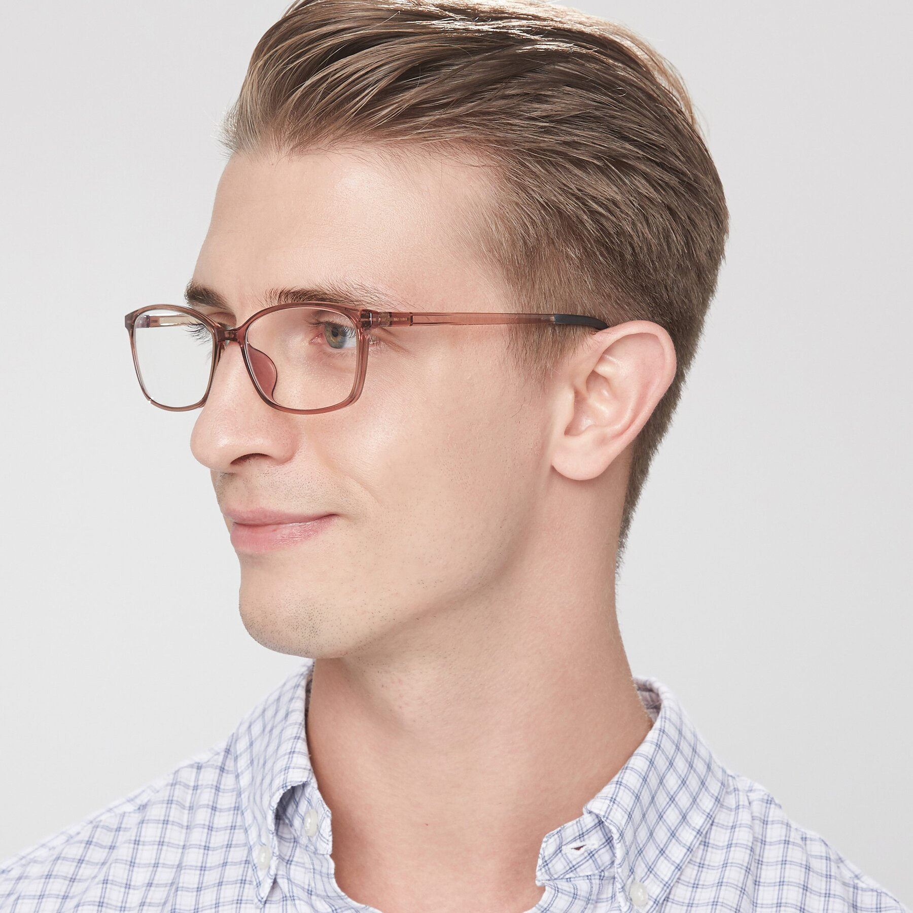 Men's lifestyle photography of S7036 in Transparent Brown with Clear Blue Light Blocking Lenses