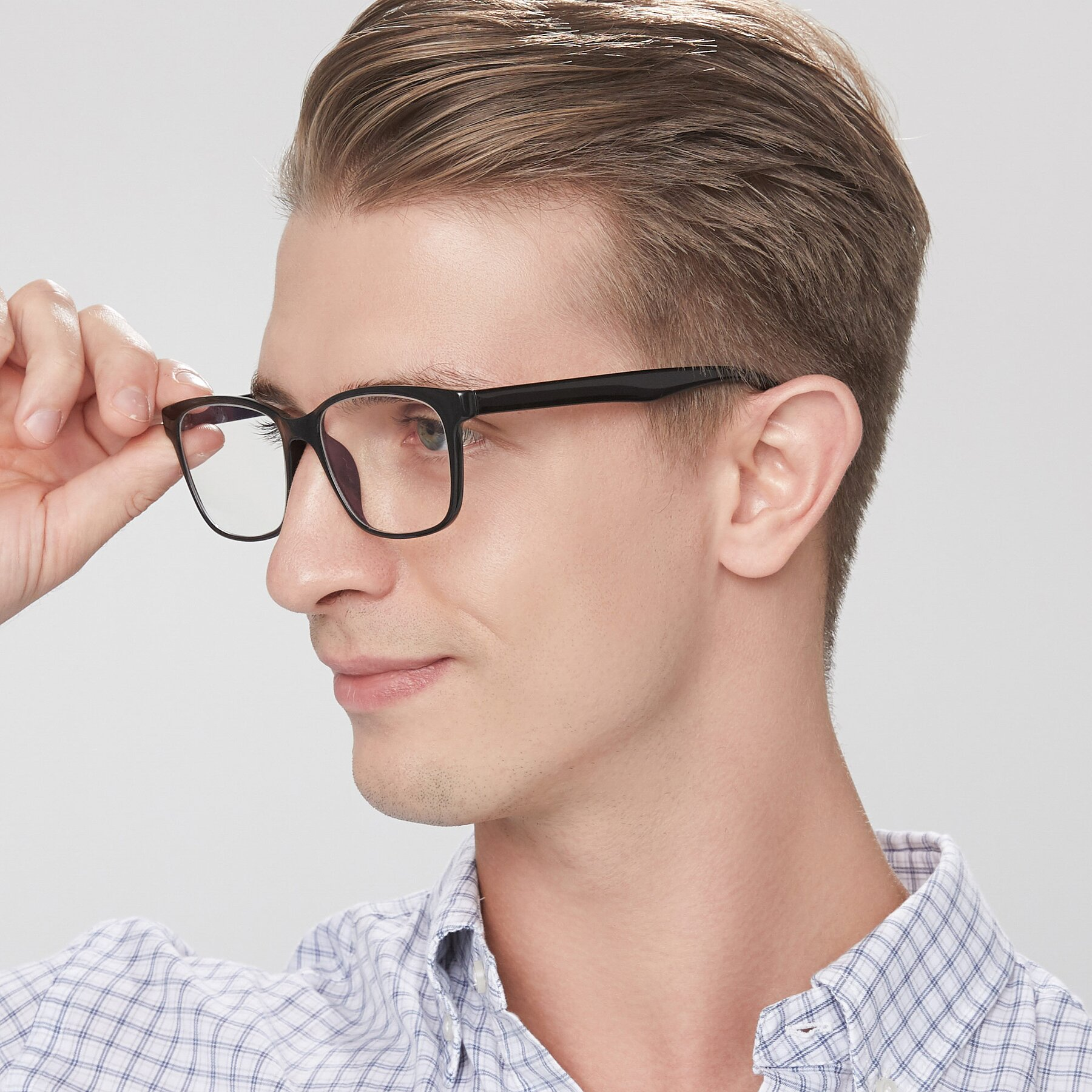Men's lifestyle photography of 8206 in Black with Clear Blue Light Blocking Lenses