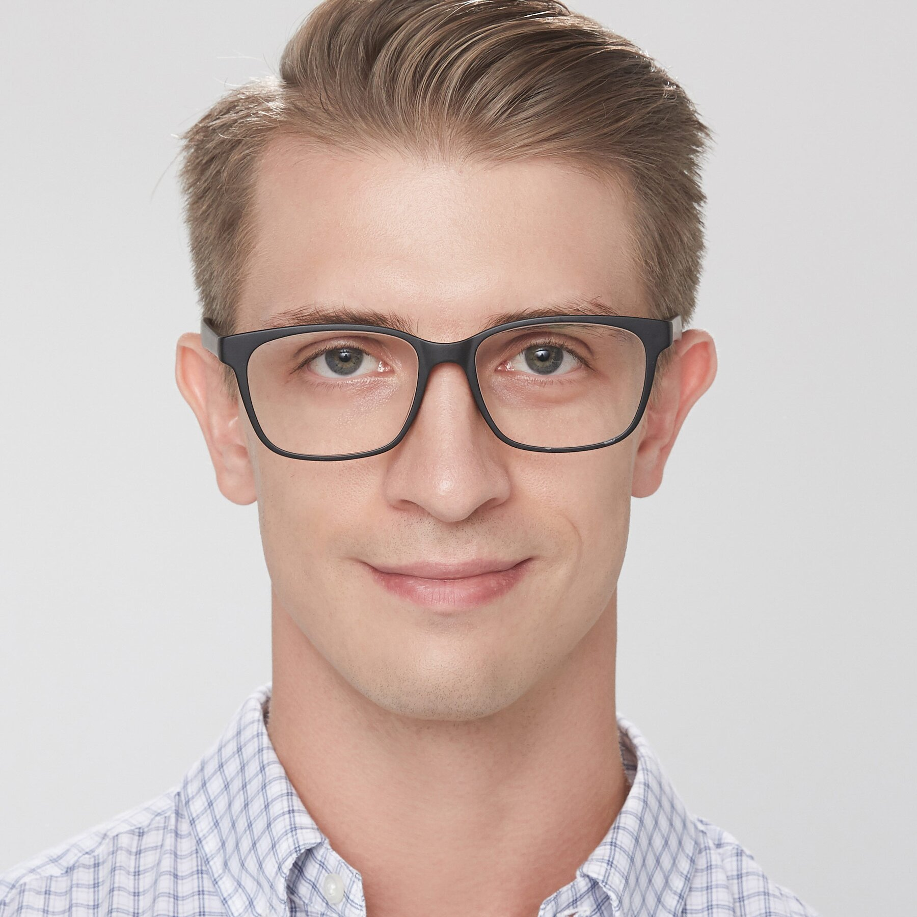 Men's lifestyle photography of 8206 in Matte Black with Clear Eyeglass Lenses