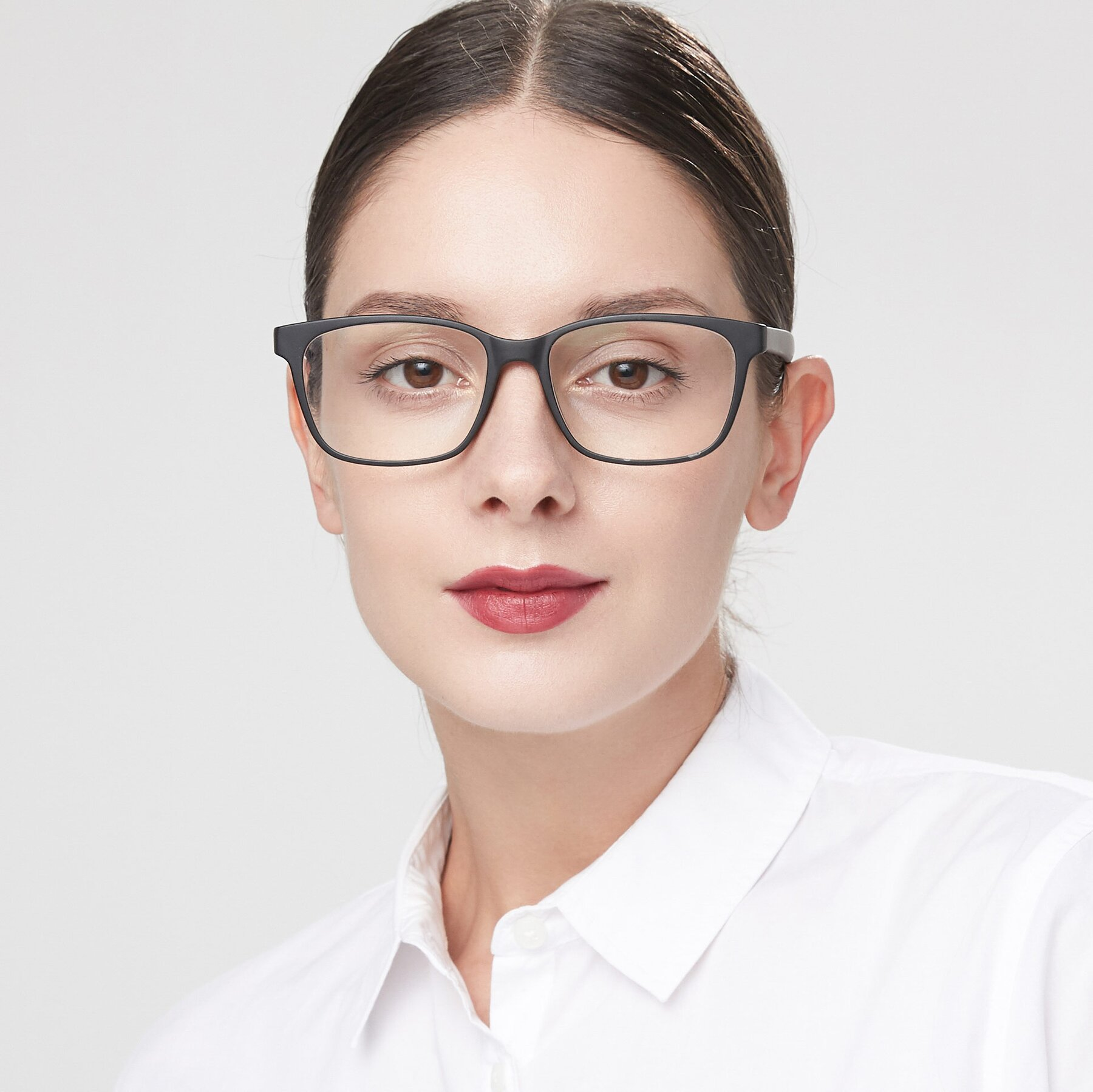 Women's lifestyle photography of 8206 in Matte Black with Clear Eyeglass Lenses