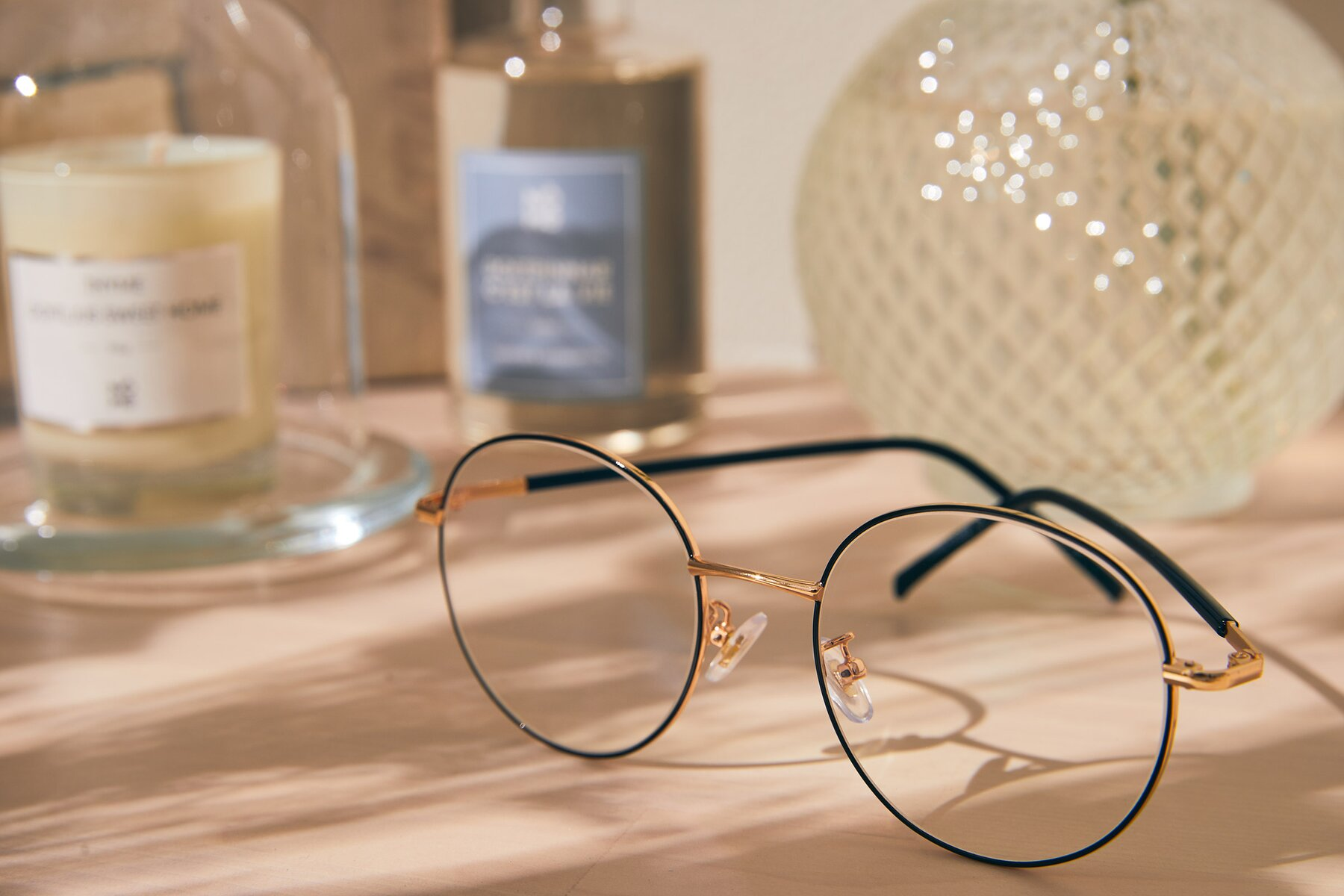 Lifestyle photography #2 of Cosmos in Black-Gold with Clear Eyeglass Lenses