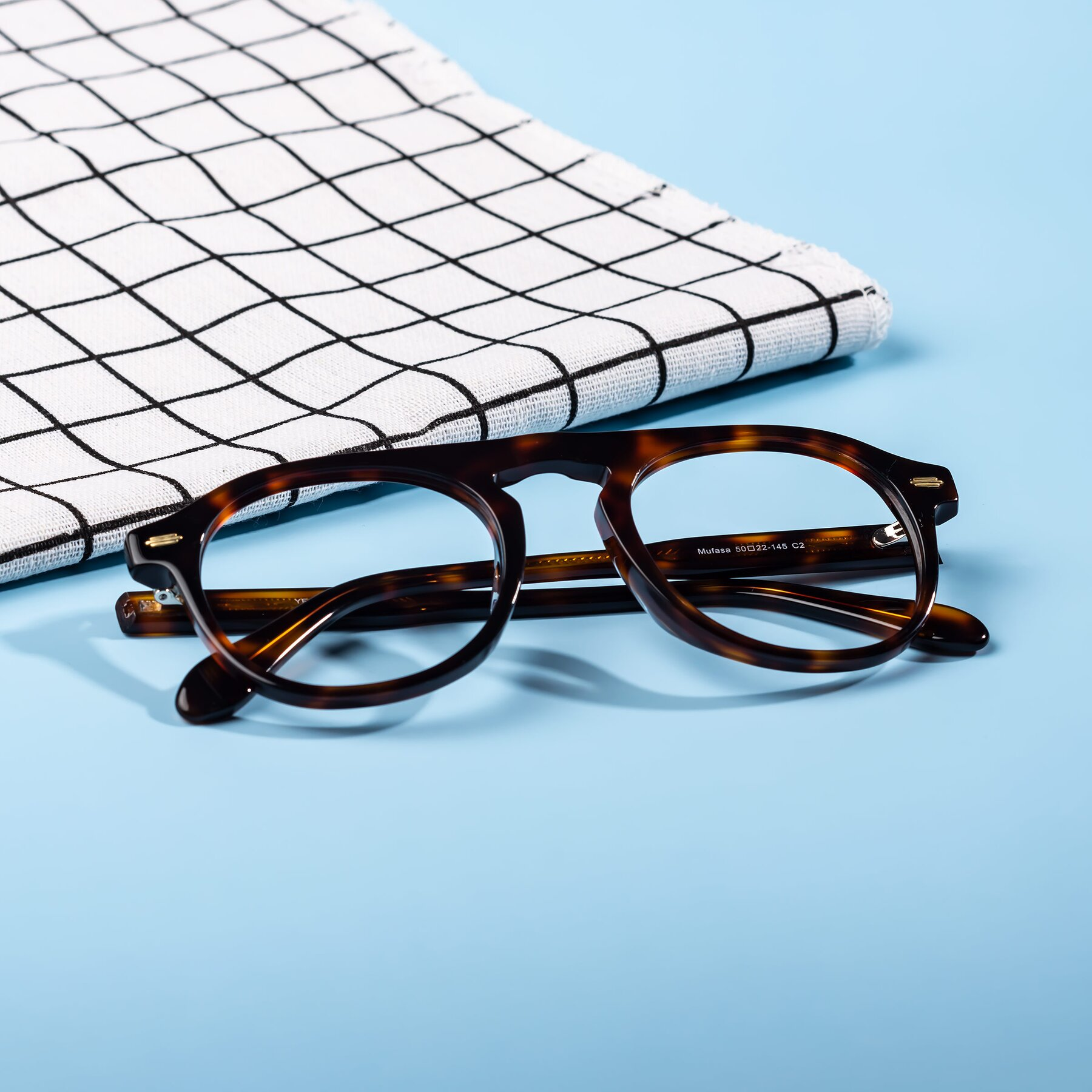 Lifestyle photography #2 of Mufasa in Tortoise with Clear Eyeglass Lenses