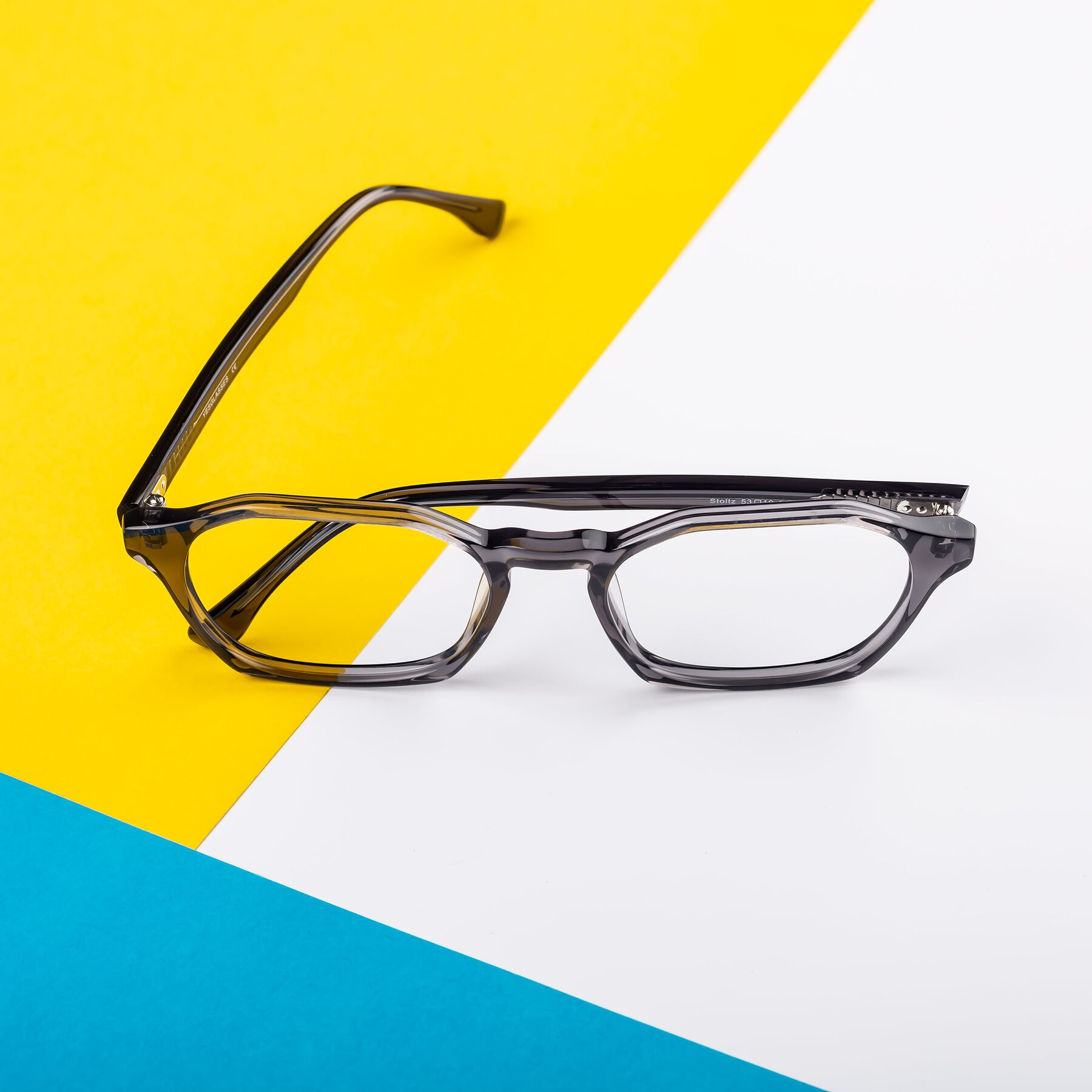 Lifestyle photography #1 of Stoltz in Translucent Gray with Clear Eyeglass Lenses