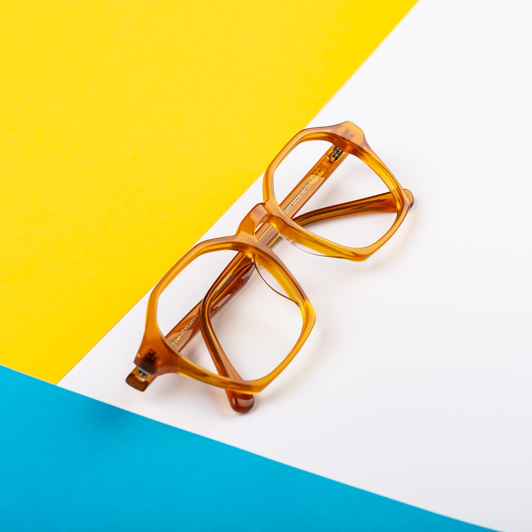 Lifestyle photography #2 of Stoltz in Brown with Clear Blue Light Blocking Lenses