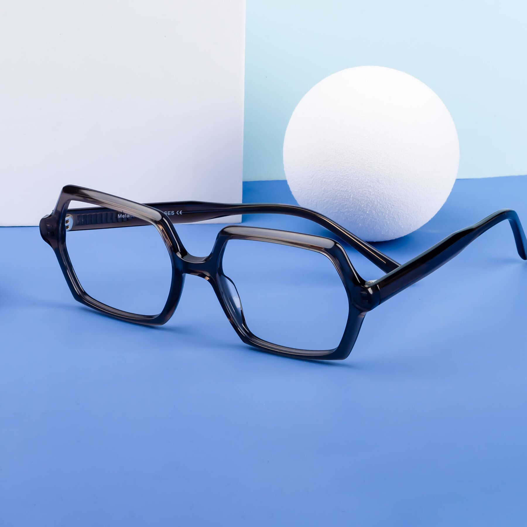 Lifestyle photography #1 of Melanie in Transparent Gray with Clear Blue Light Blocking Lenses