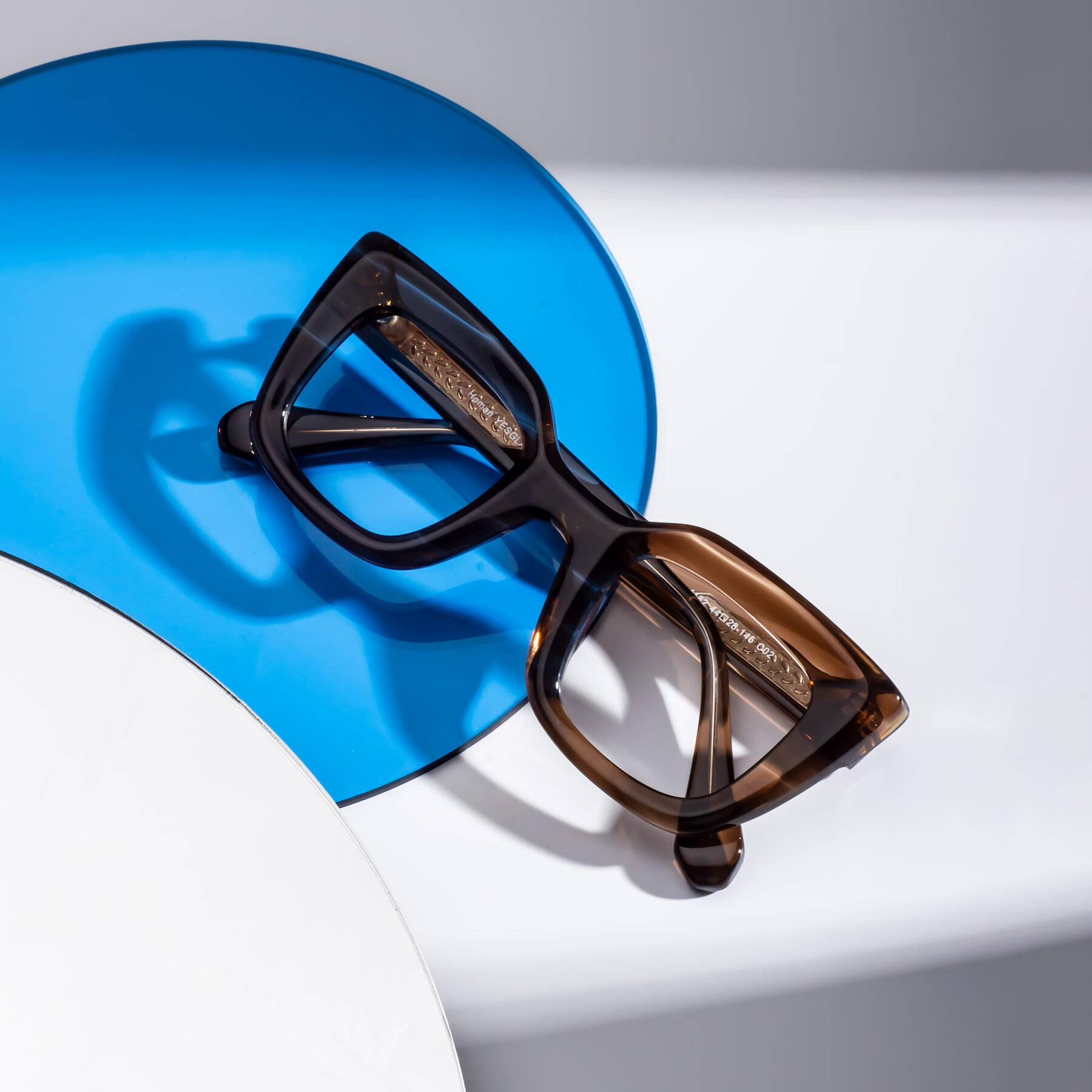 Lifestyle photography #1 of Homan in Chocolate with Clear Blue Light Blocking Lenses