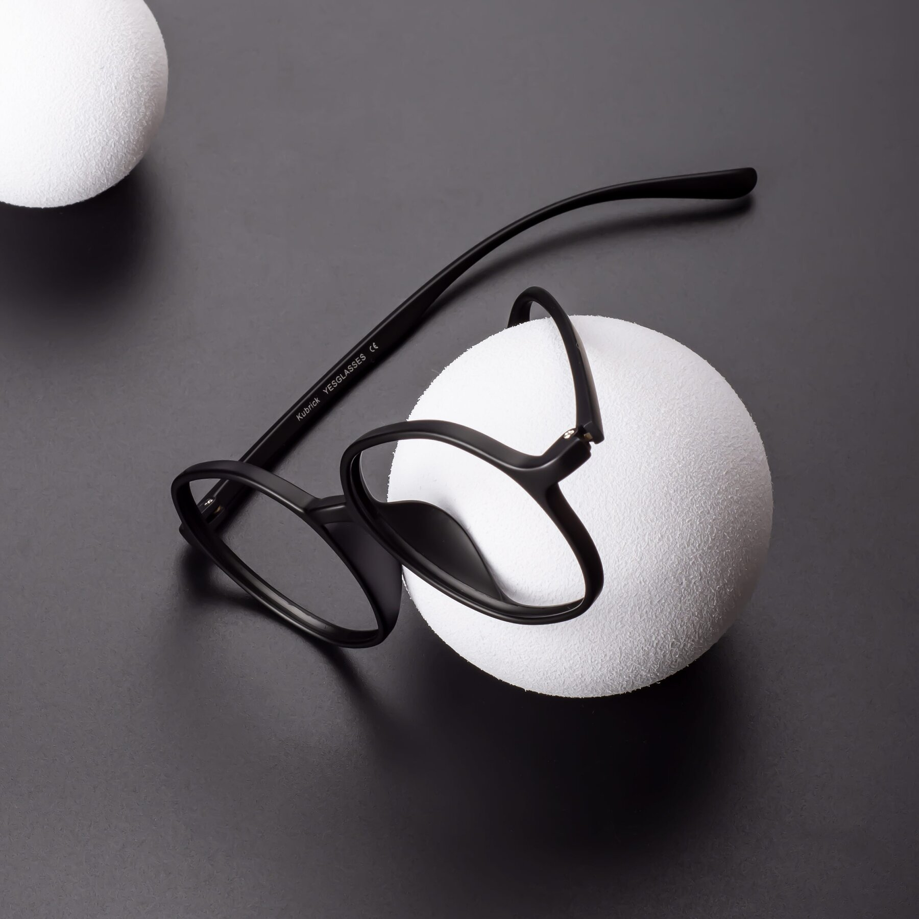 Lifestyle photography #1 of Kubrick in Matte Black with Clear Blue Light Blocking Lenses