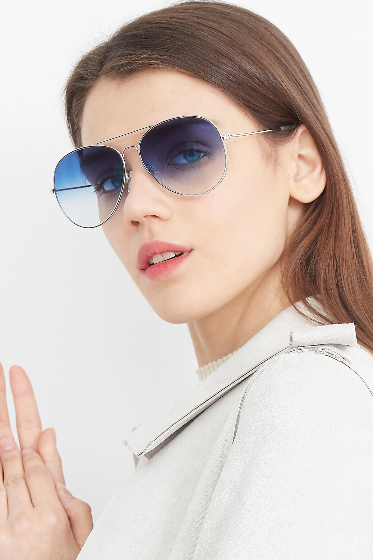 Women's lifestyle photography (portrait-2) of SSR179 in Silver with Blue Gradient Lenses