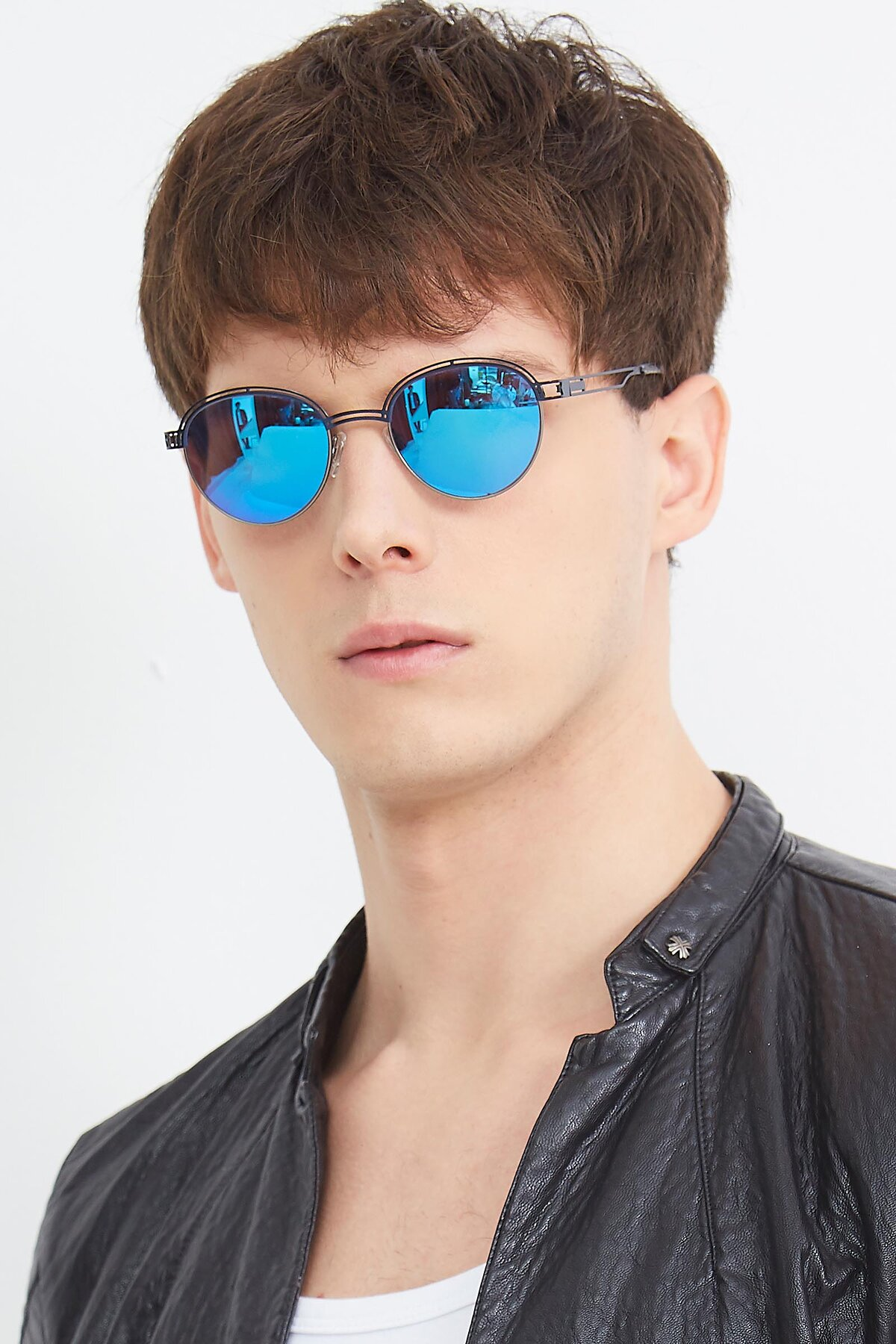 Men's lifestyle photography (portrait-2) of Marvel in Blue-Gunmetal with Blue Mirrored Lenses