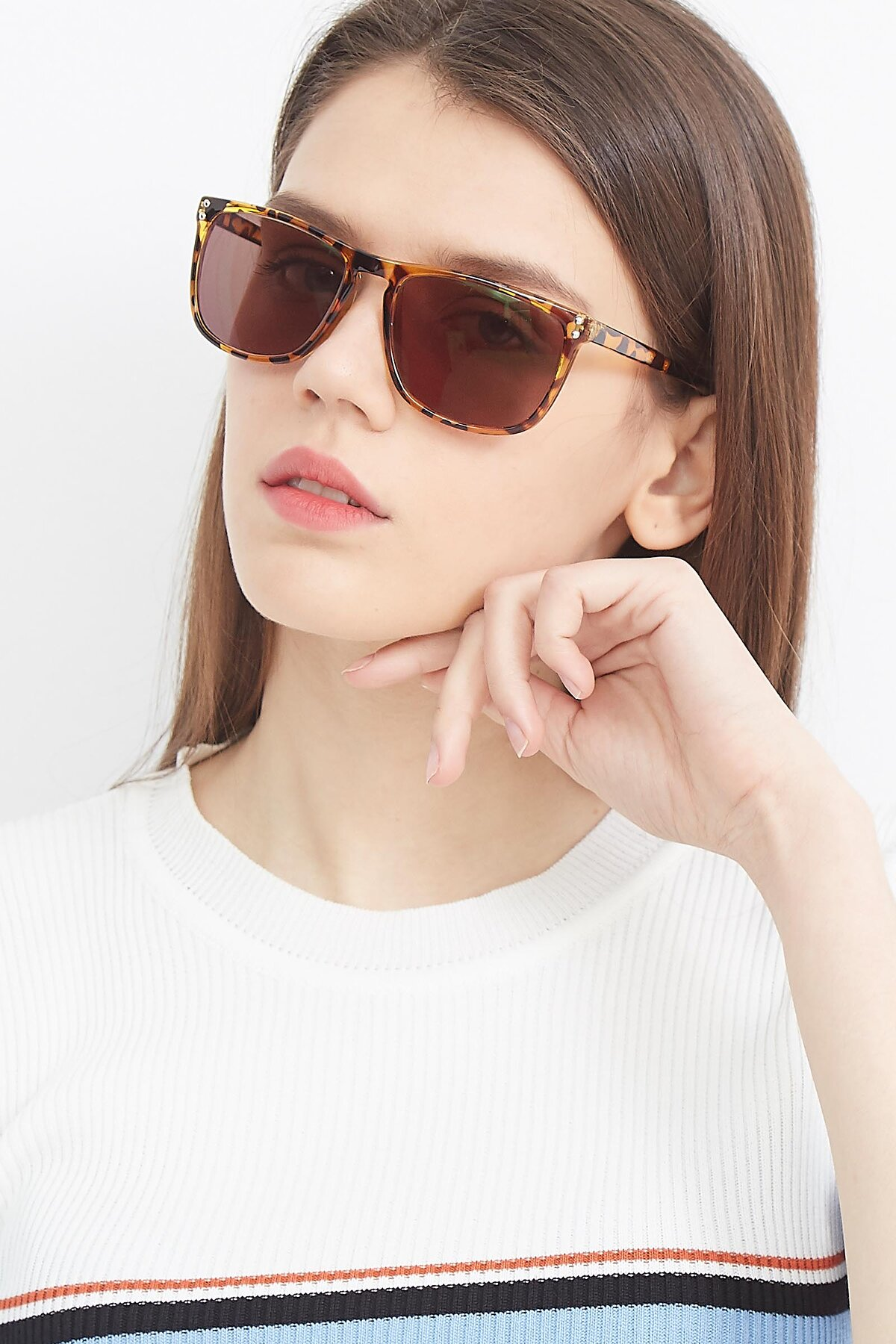 Women's lifestyle photography (portrait-1) of SSR411 in Translucent Orange Tortoise with Brown Tinted Lenses