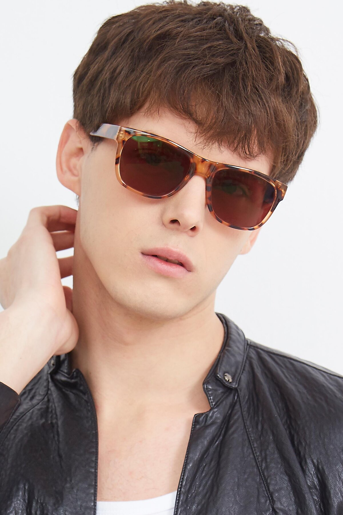 Men's lifestyle photography (portrait-2) of SSR213 in Translucent Tortoise with Brown Tinted Lenses